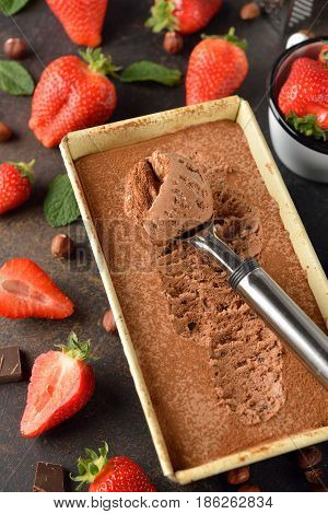 Natural chocolate ice cream on a brown background