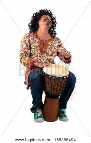 Musician man playing the djembe isolated on white.