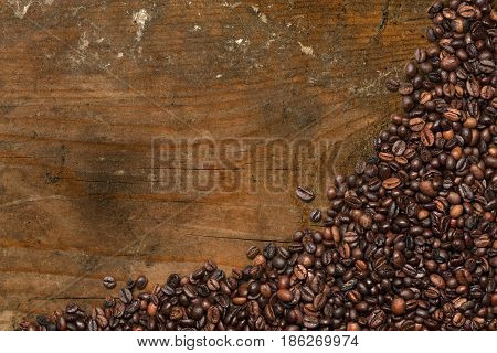 Group of roasted coffee beans on wooden background with copy space