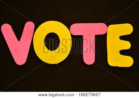 word vote on a  abstra black background