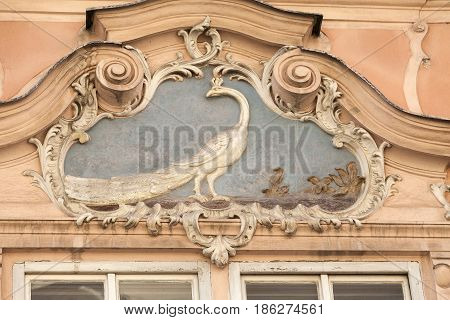 Relief on facade of old building peacock Prague Czech Republic Europe