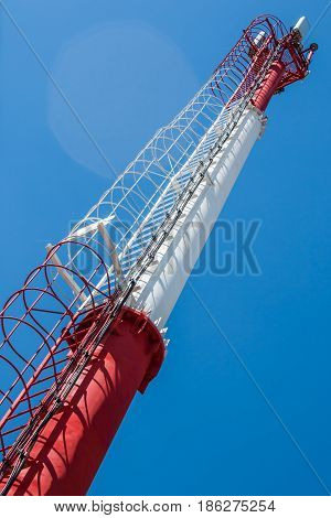 Signal tower GSM, telecommunication tower on blue sky background