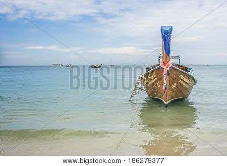 Traditional long tail boat on Railay Beach with blue sea and blue sky background, Krabi, Thailand. (HDR filter effect)