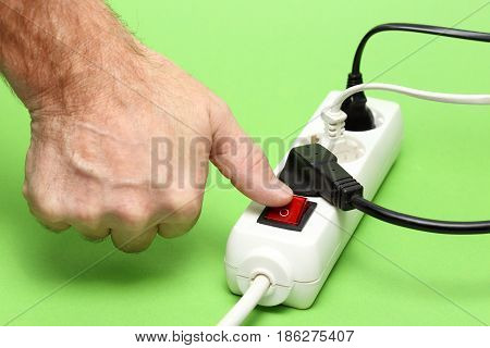 thumb is switching on a electrical device