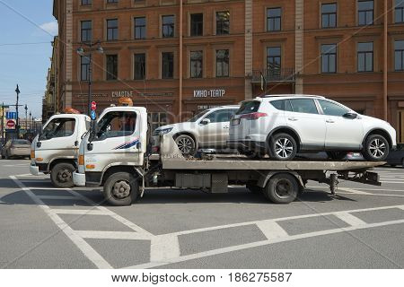 ST PETERSBURG, RUSSIA - APRIL 10, 2017: Two Hyundai HD78 car tow trucks with immersed cars