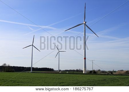 wind wheels on a field are producing energy