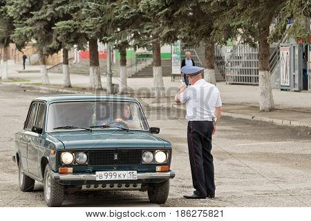 A Policeman Shows The Driver The Direction In Bypass Is Closed For Holiday Roads