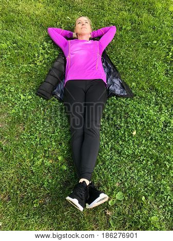 Young Woman Relaxing On Green Grass