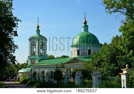 Beautiful Russian Orthodox Church, located in the shadow of the park of a big city, is waiting for its parishioners