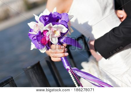 Wedding bouquet in hand bride. The concept of marriage and love. accessories marriage closeup.