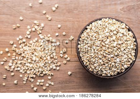 Millet Rice Or Millet Grains In Wooden Bowl Put On Wooden Table Background