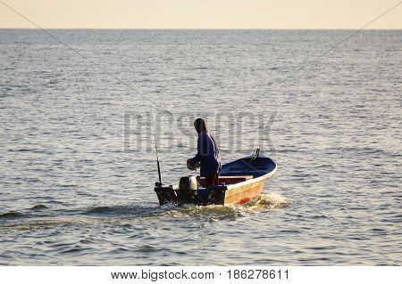 Labuan,Malaysia-May 10,2017:Traditional fisherman,going to fishing with fishing boat during morning in Tanjung Aru,Labuan,Malaysia.Aquaculture industry has growth,to contributes the economy of Labuan.