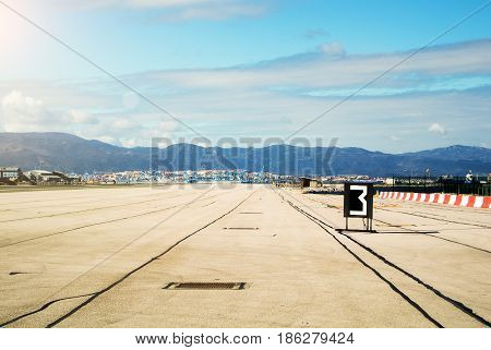 Morning With Down Sun Lights At The Runway Of Gibraltar Airport, Mountains And Algeciras Port At The
