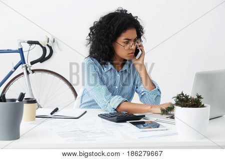 Confident Serious Professional Female Investment Advisor In Eyewear Keyboarding On Laptop Pc And Hav