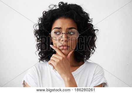 Education, People And Life Goals. Headshot Of Attractive Mixed Race Schoolgirl Wearing Stylish Round