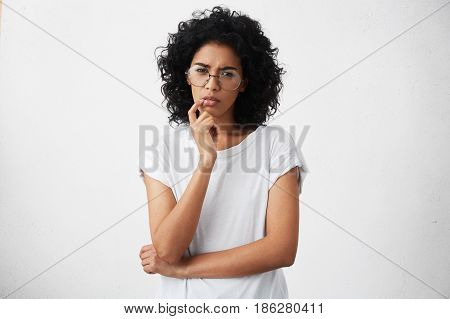 Human Emotions, Feelings, Reaction And Attitude. Attractive Girl In Casual T-shirt And Round Glasses