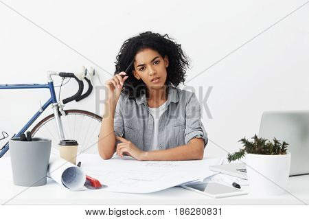 Pensive Mixed Race Female Student Architect With Black Curly Hair Scratching Head With Pencil, Havin