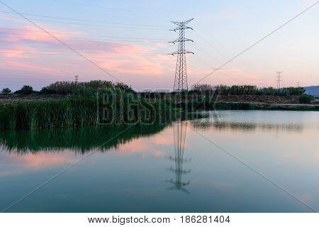 High voltage post. Highvoltage tower sky background.