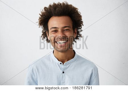 Friendly Looking Positive Afro American Stylish Man With Funky Hair And Bristle Smiling Broadly Duri