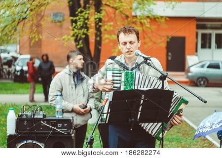 Russia Siberia Novokuznetsk - may 9 2017: musicians sing songs on the street on victory day