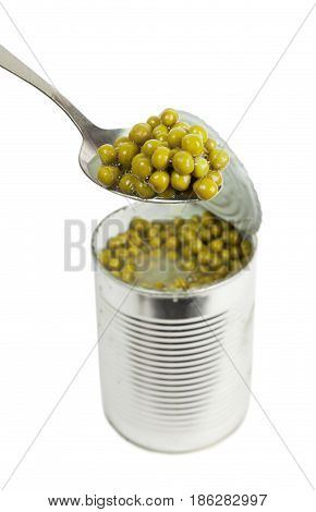 Preserved Peas Vegetable In Metal Spoon Closeup Isolated On A White Background