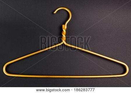 Modern yellow hanger on a black background