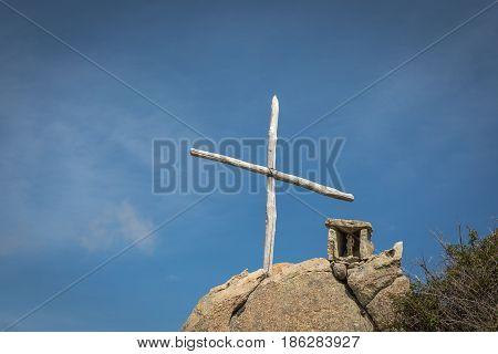 Wooden Cross And Memorial On Rock In Corsica