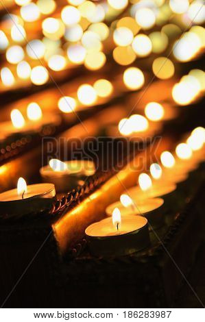 Burning candles in the dark with soft focus