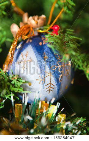 Christmas ball on the tree on blue