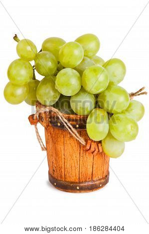 Grapes in a bucket isolated on a white background