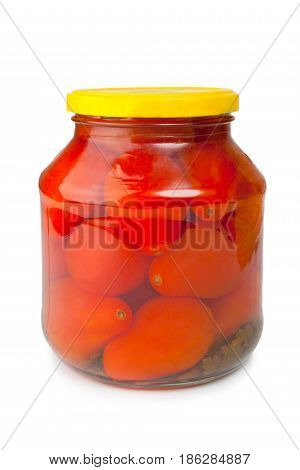 Canned tomatoes in glass jar isolated on white