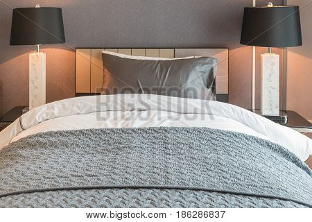 Single Bed With Black Lamp In Classic Style Bedroom
