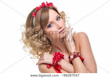 Beautiful blond young woman with red ribbon headband and bracelets. Beauty shot on white background. Isolated. Copy space.