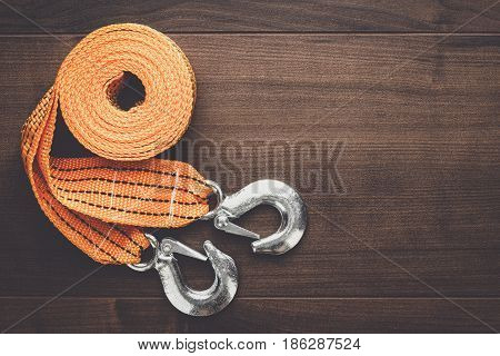 orange tow rope on the wooden table