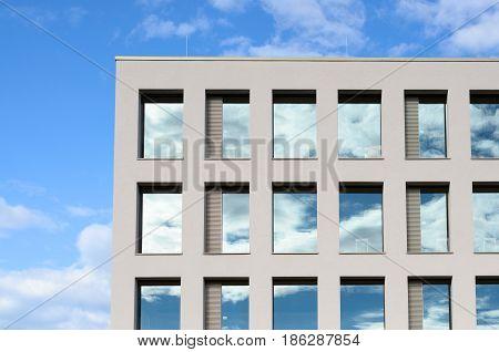 Windows In A Modern Office Block Reflect The Sky
