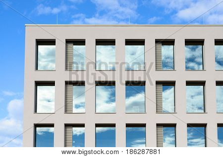 Windows In A Modern Office Block Reflect The Sky