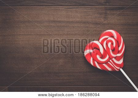red sugar lollipop on the wooden table