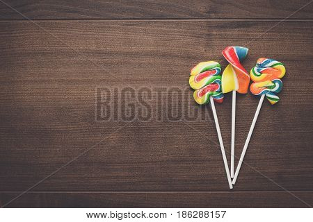 colorful sugar lollipop on the wooden table