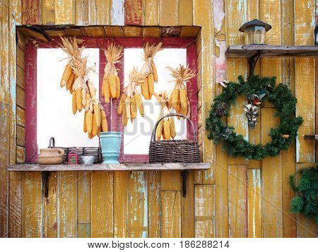 Vintage wall. Red window and decorative object hang on yellow wooden grunge wall.