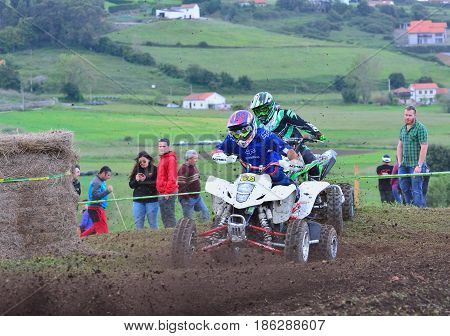Unidentified Racers Rides A Quad Motorbike.