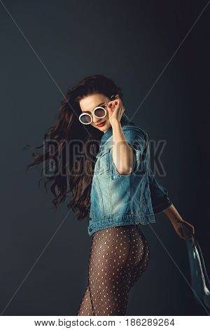 Gorgeous Girl With Red Lips White Sunglasses In A Blue Jacket Red High Heel Shoes And Transparent Ti