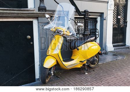 Classic Yellow Vespa Scooter Stands Parked