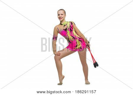beautiful blond teen age gymnast girl making exercises with maces. Studio shot isolated on white background. Copy space.