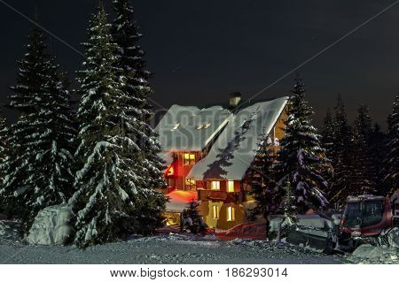 Small fairy-tale comfy house in winter snowy mountains near Dragobrat famous ski resort, Carpathians, Ukraine