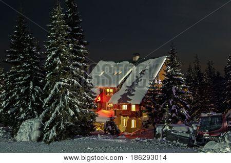 Small fairy-tale comfy house in winter snowy mountains near Dragobrat famous ski resort, Carpathians, Ukraine