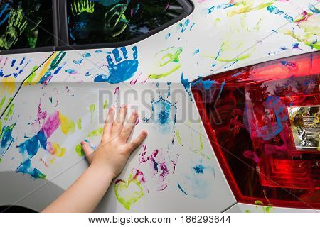 Little girl with colorful car colorful car decoration multi-color handprint