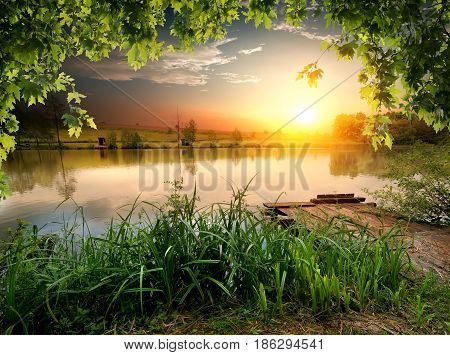 Tranquil fishing lake in the sunny evening