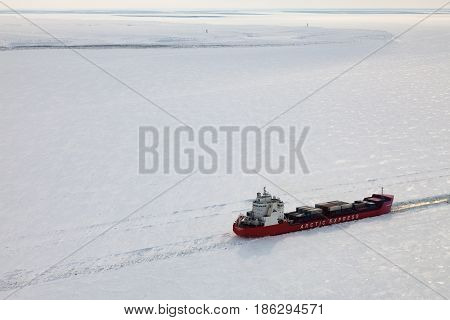 Lower reach of Yenisei river, Siberia, Russia - March, 29, 2017, icebreaker Zapolyarny on the frozen Yenisei river during shipping route from Norilsk to Murmansk in winter, slice of life, editorial. Aerial view.
