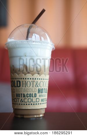 Iced mocha with straw in plastic cup ice coffee