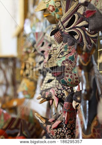 wooden mask painted with batik style hand made craft from yogyakarta Indonesia